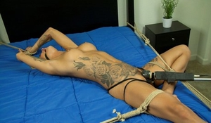 Tattooed blonde Kleio Valentien is force masturbated while gagged and tied up