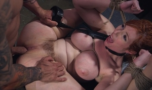 Busty redhead Lauren Phillips is gagged and bound up with rope for a hard fuck