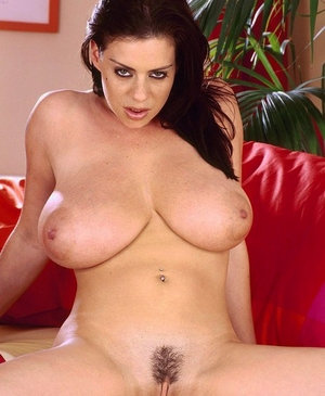 Big titted female Linsey Dawn McKenzie elations herself with a blue sex fucktoy