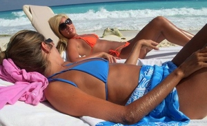 Hirsute blonde Lori Anderson relaxes on a beach in her bikini and sunglasses