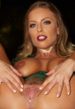 Beautiful blonde Britney Amber crosses her bare gams before spreading her twat