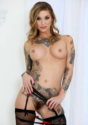 Tattooed woman Kleio Valentien sucks the cum from a pipe after gagging on it