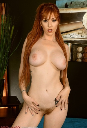 Sexy redhead Lauren Phillips removes hot lingerie to model totally naked