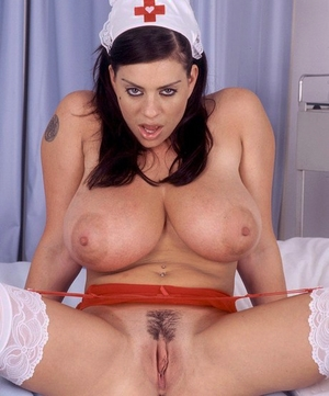Brunette nurse Linsey Dawn McKenzie uncovers hefty tits before fun with lovemaking toy
