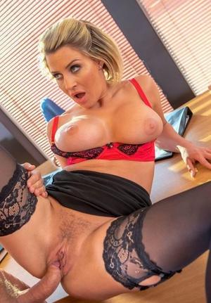 Busty office slut Sienna Day deepthroats off the boss wearing ebony stockings