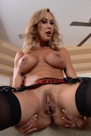 Luxury Brandi Love in black lingerie and leather harness flashes tits and pussy