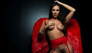 Alluring brunette MILF Kirsten Price frees her tits from a red bra