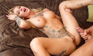 Tattooed blonde Kleio Valentien lets her massive hooters hang liberate