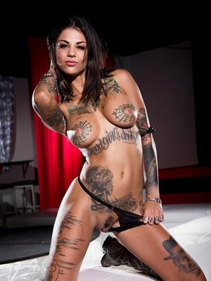 Tattooed brunette Dahlia Sky modeling bare in leather boots