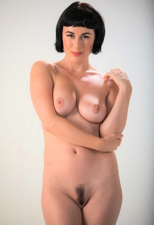 Dark haired lady Olive Glass removes glasses before standing naked