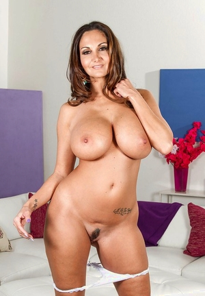 Big-boobed Latina wifey Ava Addams poses fully clothed before stripping nude