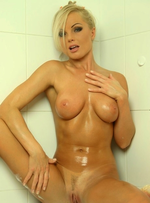 Hot blondie girl with firm melons Silvia Saint takes a sudsy bath