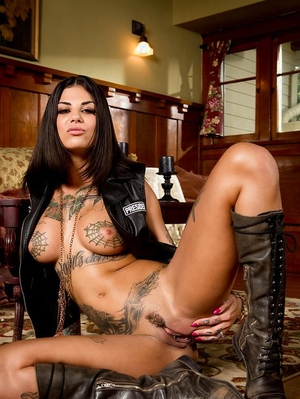 Tattooed pornstar Bonnie Rotten modeling solo in leather jacket and boots