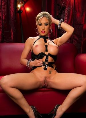 Blonde fetish model Capri Cavanni in leather showing closeup pussy & enormous tits
