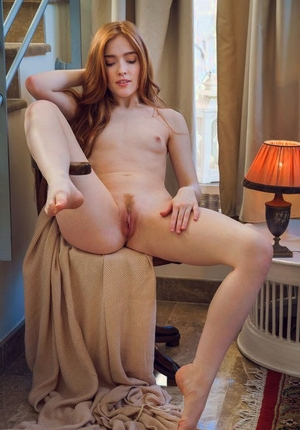 Young redhead Jia Lissa liquidates long sleeved shirt and undies to pose bare