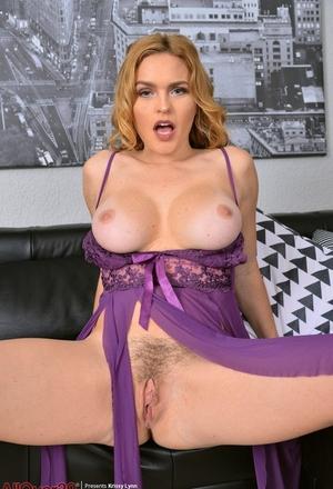 Flawless MILF Krissy Lynn enjoys spreading her furry meaty cunt on the sofa