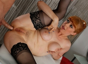 Redhead masseuse Penny Pax sports a creampie after fucking a client