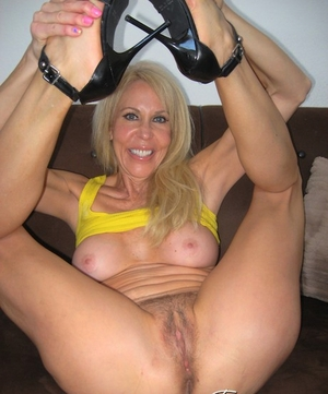 Older blonde damsel Erica Lauren pulls out a sex toy while getting fucked