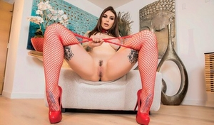 Collared female Ivy Lebelle bangs a hefty black cock in red mesh pantyhose