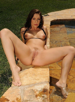 Fascinating dark haired babe Gracie Glam is revealing her ass at the pool