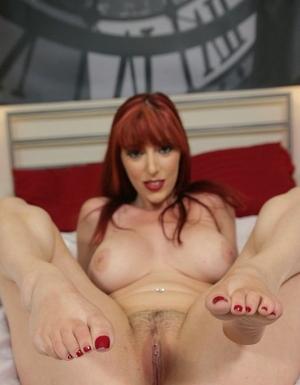 Hot redhead Lauren Phillips shares her superb big orbs for POV titjob & bang