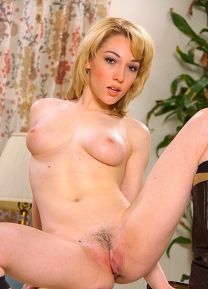 Solo girl Lily LaBeau undresses to her leather boots and socks