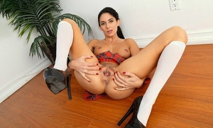 Leggy MILF Nikki Daniels strips off her schoolgirl clothing to model naked