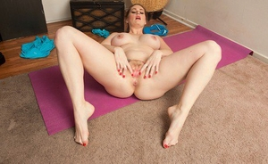 MILF solo girl Allison Moore unleashing big breasts from sports hooter-sling