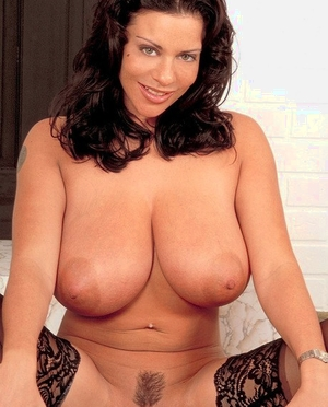 Dark-haired chick Linsey Dawn McKenzie struts her stuff in black nylons and shoes