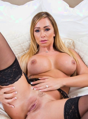 Blonde pornographic star Destiny Dixon posing sexily in lingerie and high heels