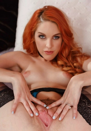 Sexy Euro redhead Amarna Miller showing off pink pussy during lingerie removal