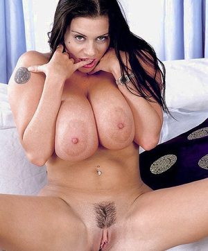 Linsey Dawn McKenzie removes lingerie to pose her massive tits and snatch