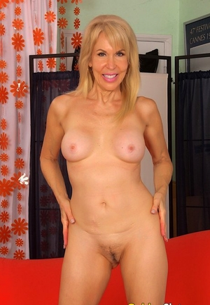 Smiley steaming granny Erica Lauren displaying off firm tits & opening up toned legs