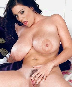 Euro MILF Linsey Dawn McKenzie unveiling huge baps for self nipple licking