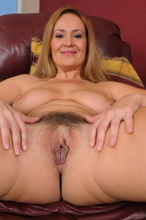 Busty secretary Elexis Monroe plays with her pussy hair and shows meaty clit