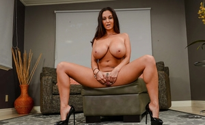 European MILF pornstar Ava Addams showing off knockers and big butt in high-heeled slippers