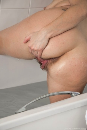 Blonde MILF with small tits & fat ass Anna Joy teases her bush in the bathtub