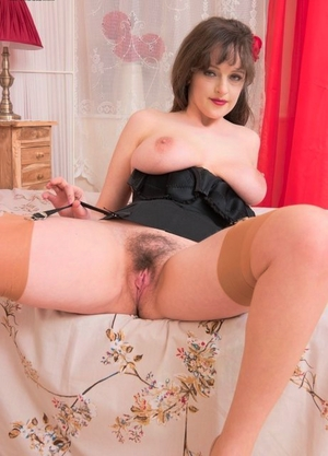 Hot MILF Kate Anne shows her pubic hair in tan nylons after doffing a see thru skirt