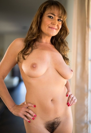 Brunette MILF Elexis Monroe uncovers her natural jugs prior to standing naked
