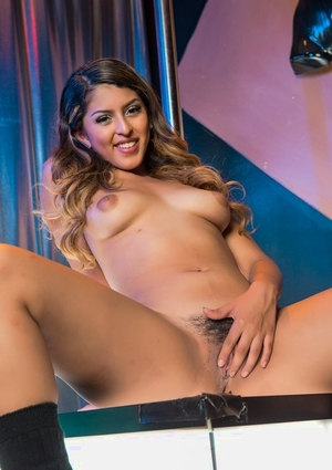 Beautiful Latina stripper Sophia Leone plays with her trimmed muff after striptease