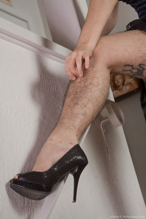 Hairy women black legs and pussy - 4
